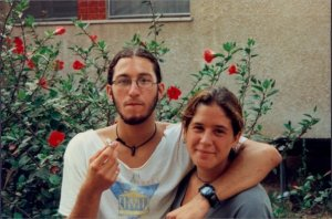 Michele and Nitzan, Pardess Chana, 1996, in front of a Hibiscus!